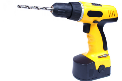 Hand yelow drill isolated